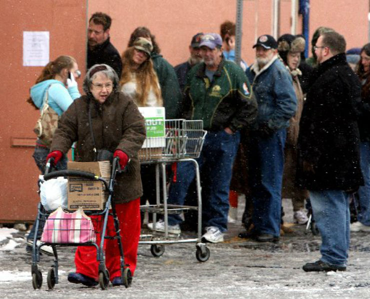 men women children line up to receive groceries at the Thurston County food bank